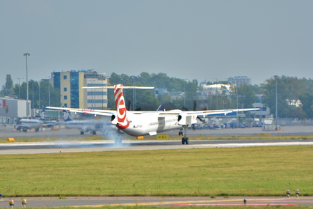 warsaw chopin: This is a view of the Eurolot plane Bombardier Dash 8 Q400 registered as SP-EQB on the Warsaw Chopin Airport. September 16, 2015, Warsaw, Poland.