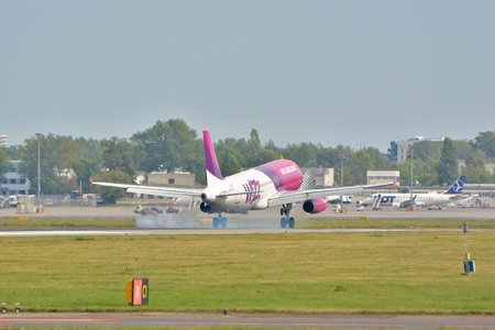 This is a view of the airlines Airbus A320 plane registered as HA-LPV on the Warsaw Chopin Airport. September 16, 2015, Warsaw, Poland.
