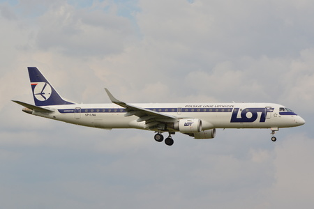 warsaw chopin: This is a view of LOT Polish Airlines Embraer ERJ 195 plane registered as SP-LNA on the Warsaw Chopin Airport. September 16, 2015.