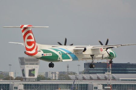 warsaw chopin: This is a view of Eurolot plane Bombardier Dash 8 Q400 registered as SP-EQE in special painting on the Warsaw Chopin Airport. September 16, 2015, Warsaw, Poland. Editorial