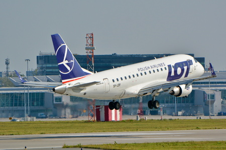 warsaw chopin: This is a view of LOT - Polish Airlines plane Embraer ERJ-175 registered as SP-LDF on the Warsaw Chopin Airport. September 16, 2015, Warsaw, Poland. Editorial