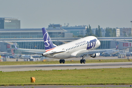 chopin: This is a view of LOT - Polish Airlines plane Embraer ERJ-175 registered as SP-LDF on the Warsaw Chopin Airport. September 16, 2015, Warsaw, Poland. Editorial