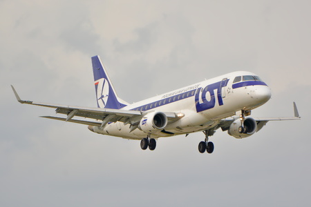 warsaw chopin: This is a view of LOT Polish Airlines Embraer ERJ 175 plane STD registered as SP-LIL on the Warsaw Chopin Airport. September 16, 2015, Warsaw, Poland.