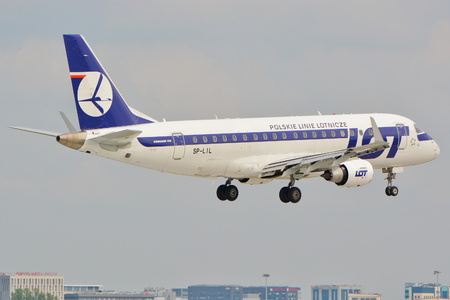 chopin: This is a view of LOT Polish Airlines Embraer ERJ 175 plane STD registered as SP-LIL on the Warsaw Chopin Airport. September 16, 2015, Warsaw, Poland.