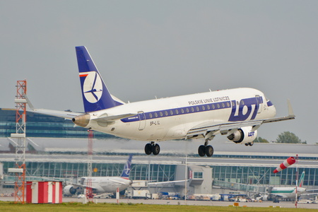 std: This is a view of LOT Polish Airlines Embraer ERJ 175 plane STD registered as SP-LIL on the Warsaw Chopin Airport. September 16, 2015, Warsaw, Poland.