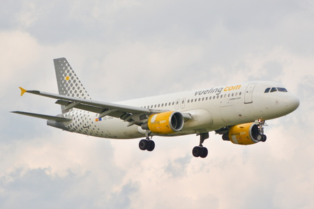 chopin: This is a view of Vueling Airbus A320 plane registered as EC-HHA on the Warsaw Chopin Airport. September 16, 2015, Warsaw, Poland.
