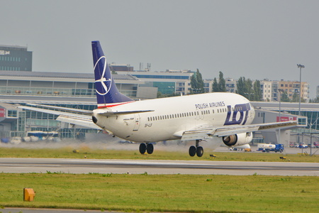 chopin: This is a view LOT Polish Airlines Boeing 737-45D plane registered as SP-LLF on the Warsaw Chopin Airport. September 16, 2015, Warsaw, Poland.