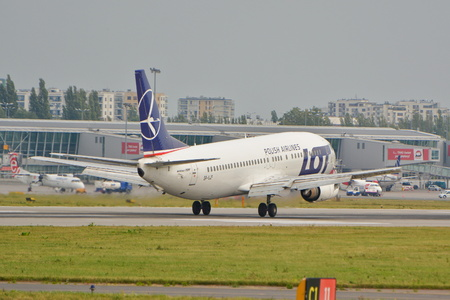 warsaw chopin: This is a view LOT Polish Airlines Boeing 737-45D plane registered as SP-LLF on the Warsaw Chopin Airport. September 16, 2015, Warsaw, Poland.