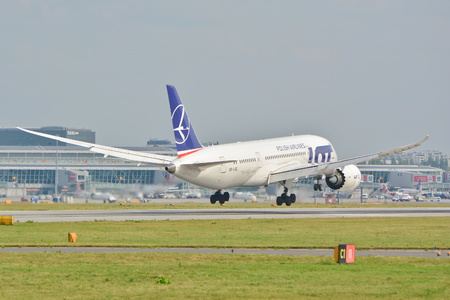 warsaw chopin: This is a view of a Boeing 787-8 Dreamliner on the Warsaw Chopin Airport. September 16, 2015, Warsaw, Poland.