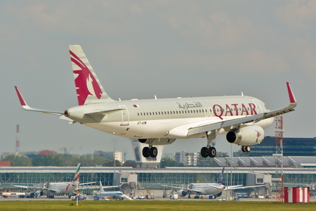 warsaw chopin: This is a view of Qatar Airways Airbus A320 plane registered as A7-AHW on the Warsaw Chopin Airport. September 16, 2015, Warsaw, Poland.