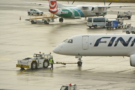 warsaw chopin: This is a view of Finnair plane Embraer ERJ 190 registered as OH-LKH outputting on the Warsaw Chopin Airport. February 2, 2016. Warsaw, Poland.