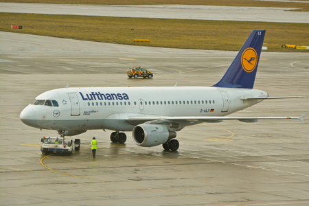 warsaw chopin: This is a view of Lufthansa plane Airbus A319 registered as D-AILX outputting on the Warsaw Chopin Airport. February 2, 2016. Warsaw, Poland.