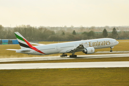 warsaw chopin: This is a view of Emirates plane Boeing 777-300 registered as A6-EBZ on the Warsaw Chopin Airport. February 2, 2016. Warsaw, Poland. Editorial