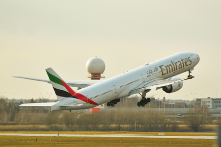 outside machines: This is a view of Emirates plane Boeing 777-300 registered as A6-EBZ on the Warsaw Chopin Airport. February 2, 2016. Warsaw, Poland. Editorial