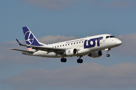 warsaw chopin: This is a view of LOT Polish Airlines Embraer ERJ 170 plane registered as SP-LDG landing on the Warsaw Chopin Airport. March 16, 2016. Warsaw, Poland.
