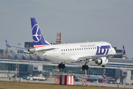 warsaw chopin: This is a view of LOT - Polish Airlines plane Embraer ERJ 175 LR registered as SP-LIF landing on the Warsaw Chopin Airport. March 16, 2016. Warsaw, Poland.