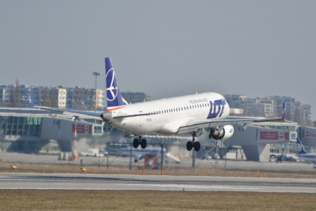 warsaw chopin: This is a view of LOT - Polish Airlines Embraer ERJ 190 plane registered as SP-LNE on the Warsaw Chopin Airport. March 16, 2016. Warsaw, Poland. Editorial