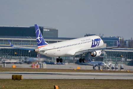 chopin: This is a view of LOT - Polish Airlines Embraer ERJ 190 plane registered as SP-LND on the Warsaw Chopin Airport. March 16, 2016. Warsaw, Poland.