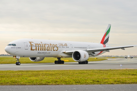 This is a view of Emirates Boeing 777-300ER plane registered as A6-EPR on the Warsaw Chopin Airport. On November 4, 2016. Warsaw, Poland.