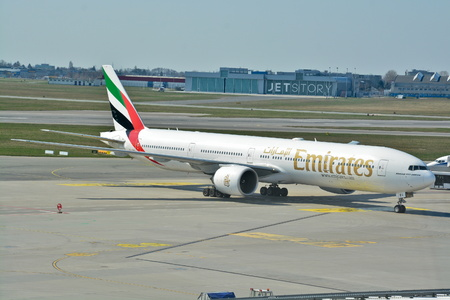 This is a view of Emirates plane Boeing 777 on the Warsaw Chopin Airport registered as A6-EBV. April 1, 2017. Warsaw, Poland.