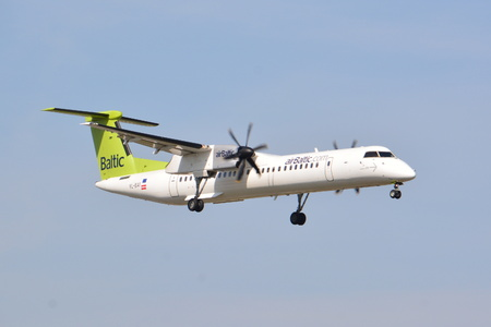 This is a view of AirBaltic plane Bombardier Q400 Dash-8 registered as YL-BAI on Warsaw Chopin Airport. April 1, 2017. Warsaw, Poland. Editorial