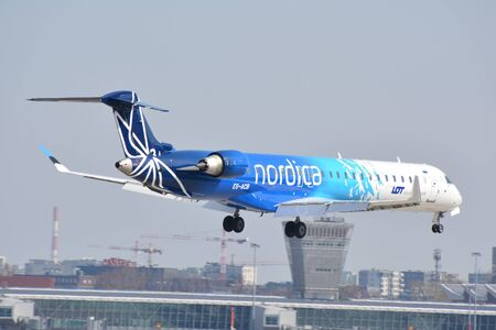 This is a view of Nordica Airline plane Canadair CL-600 registered as ES-ACB on the Warsaw Chopin Airport. April 1, 2018. Warsaw, Poland. Redactioneel