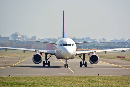 This is a view of WizzAir plane Airbus A320-232 registered as HA-LWC on the Warsaw Chopin Airport. April 1, 2017. Warsaw, Poland.