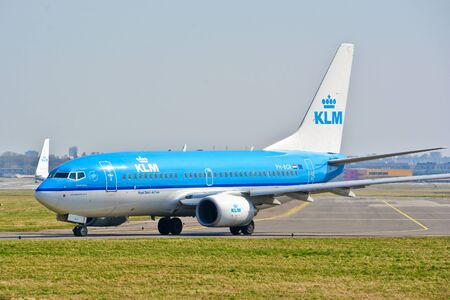 This is a view of KLM plane Boeing 737-700 registered as PH-BGR on the Warsaw Chopin Airport. April 1, 2017. Warsaw, Poland.