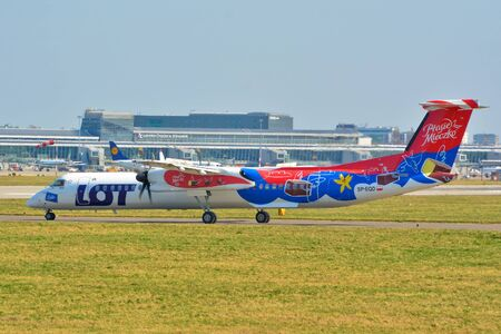 This is a view of LOT-Polish Airlines plane Bombardier Q400 Dash 8 registered as SP-EQD on the Warsaw Chopin Airport. April 1, 2017. Warsaw, Poland.