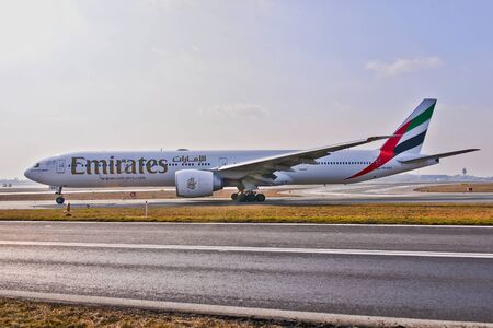 This is a view of Emirates plane Boeing 777-300R registered as A6-EQA on the Warsaw Chopin Airport.
