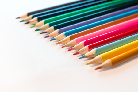 Colored Pencils isolated on white backdrop selective focus