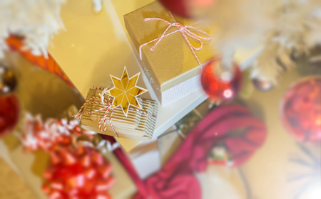 Small Boxes of Christmas presents under white christmas tree indoor, selective focus 版權商用圖片