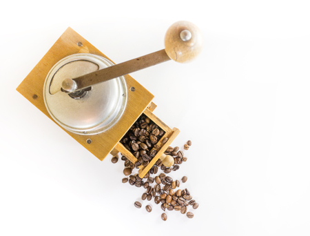 Vintage Coffee grinder and roasted coffee beans isolated on white, top view