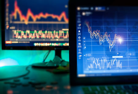 Day trader screen with graphs and charts in dark