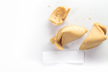 Fortune cookie isolated on white, cracked with message paper Stock Photo