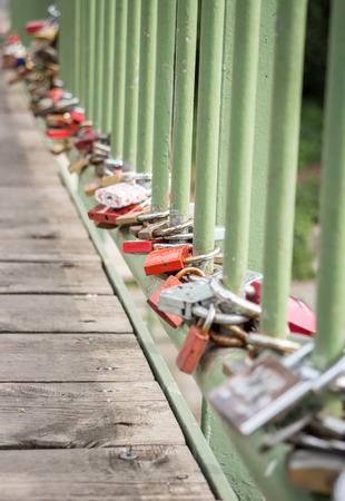 Love padlocks on old pedestrian bridge, low angle view