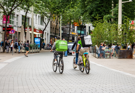 Vienna Austria May.25 2018, Uber Eats is an International food delivery company from U.S, Cyclist caring backpacks Stockfoto - 102450979