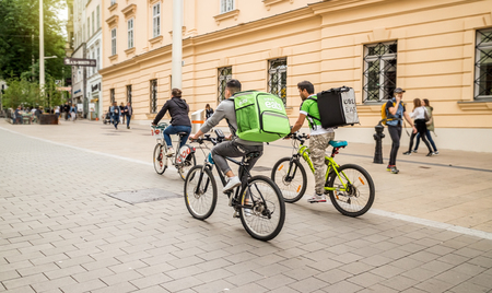 Vienna Austria May.25 2018, Uber Eats is an International food delivery company from U.S, Cyclist caring backpacks 新聞圖片