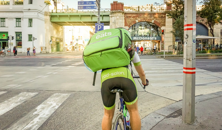 Vienna Austria September.18 2018, Uber Eats bike, international food delivery company from the U.S, cyclist caring backpack