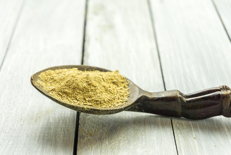 Spoon with Kava Kava root powder on wooden table Stock fotó