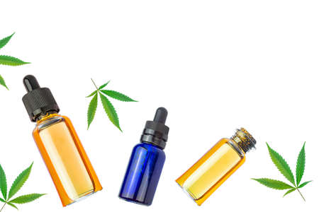 Cannabis Oil CBD or THC oils with Marijuana leaves isolated on white background with copy space