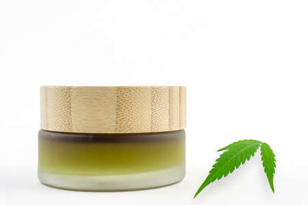 Full Spectrum CBD cannabis alternative medicine skincare cream in glass jar with copy space 版權商用圖片