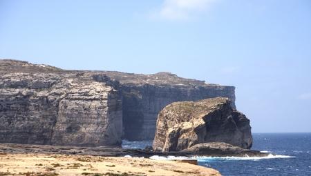 azure: Fungus Rock next to the Azure Window, Gozo Island, Malta