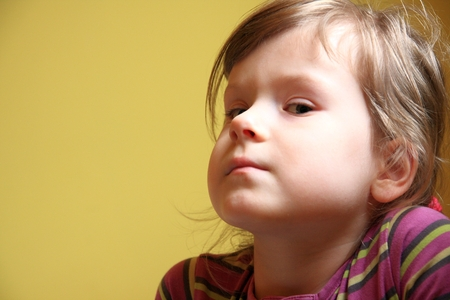 potrait: Cute little girl potrait, yellow background, natural