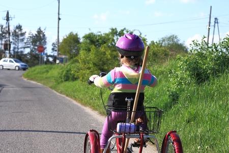three wheel: Little girl riding a three wheel rehabilitation bike