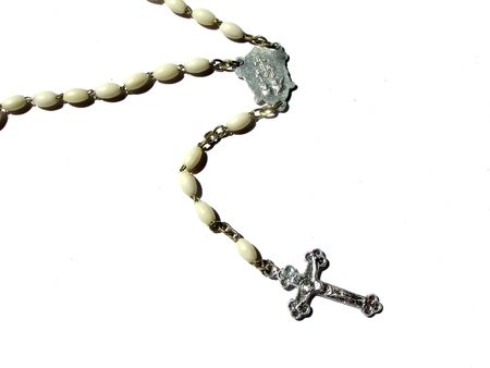 A white rosary, white background photo
