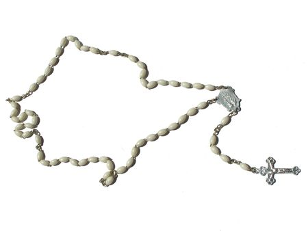 A rosary, white background photo