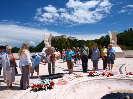of homage: Monte Cassino, Italy - June 1, 2011: a trip from Poland pays homage to the Polish soldiers who lost their lives in the battle of Monte Cassino in 1944 during World War II