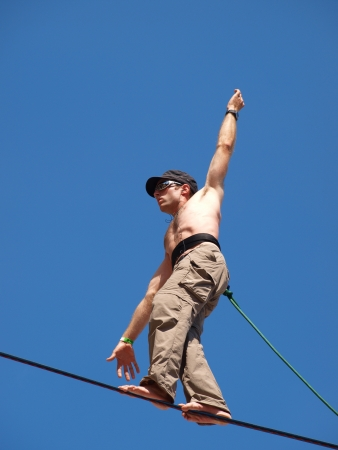 Lublin, Poland, August 21st 2010: A tightrope walker in the historic old town of Lublin during summer Festival of Circus Art (Carnival Sztuk-Mistrzow). Stock Photo - 9761209