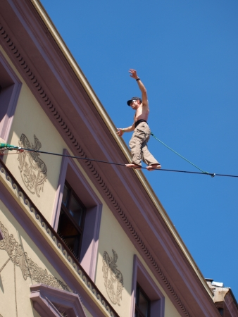 Lublin, Poland, August 21st 2010: A tightrope walker in the historic old town of Lublin during summer Festival of Circus Art (Carnival Sztuk-Mistrzow).